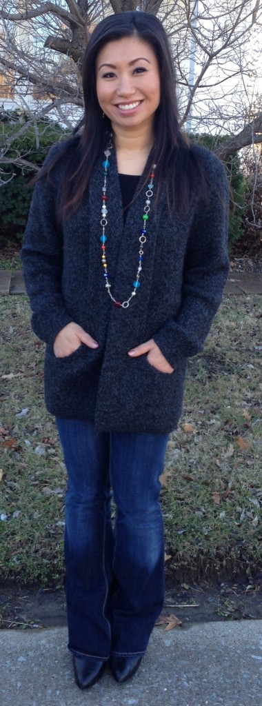This charcoal Alpaca cardigan from Peru has a sleek collar that turns into pockets at the bottom. Andrea is also wearing a beautiful necklace by Judy Dummeier.  Judy's bead and wire jewelry is just spectacular!