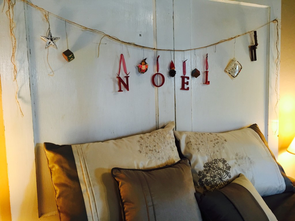 Vintage Holiday Headboard made with old doors, burlap twine and keepsake ornaments