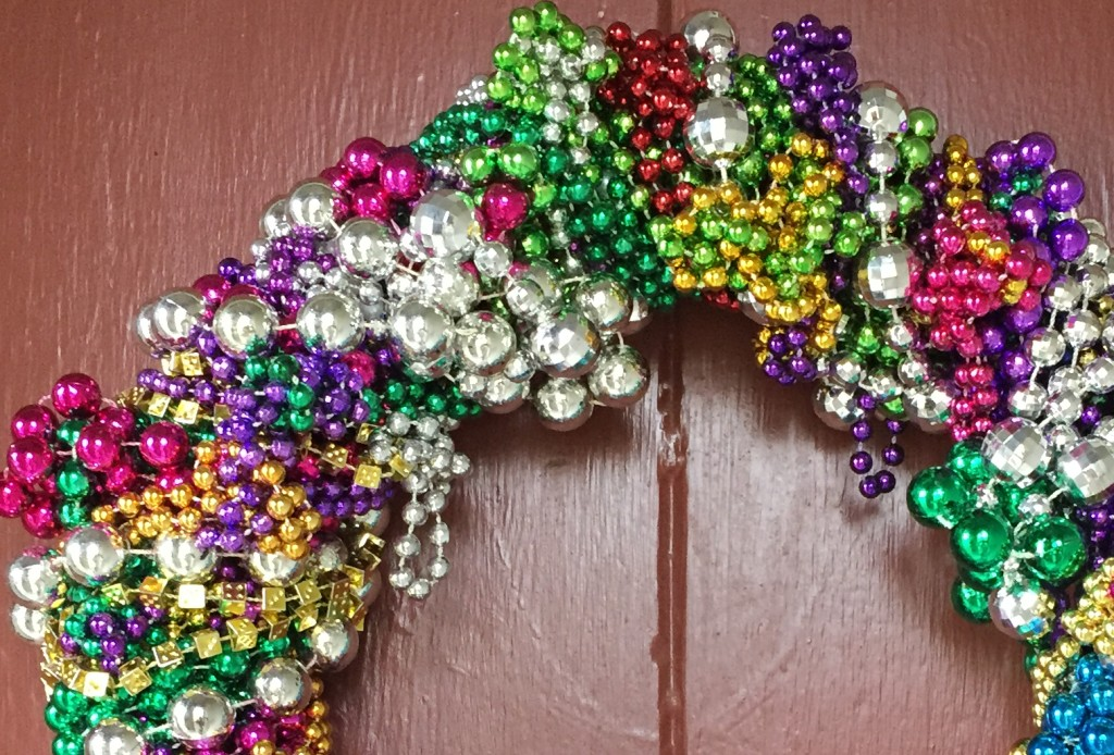 Mardi Gras bead wreath close up